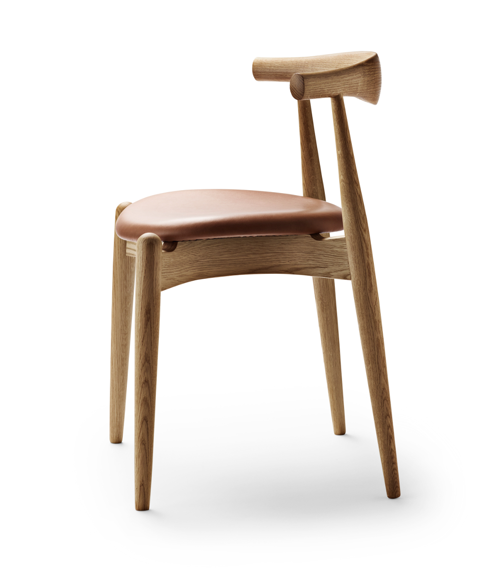 A side view of a Carl Hanson Elbow chair side view