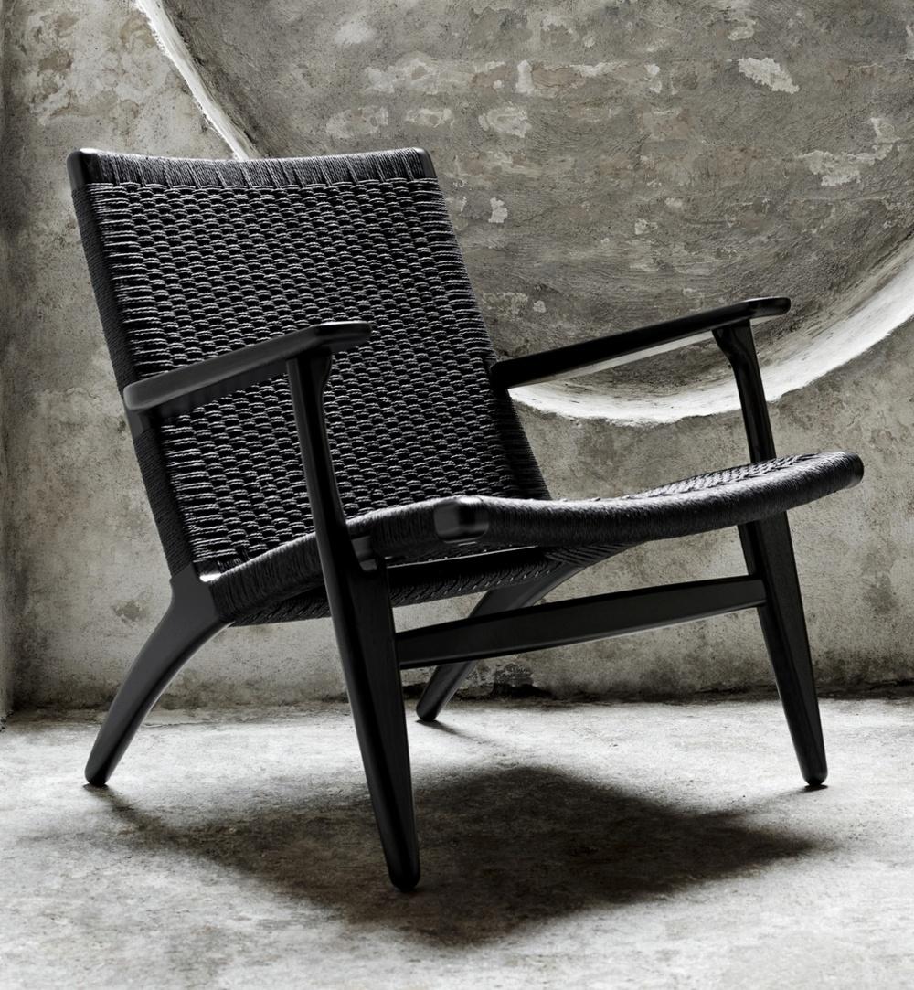 A black Carl Hansen & Søn ch25 lounge chair