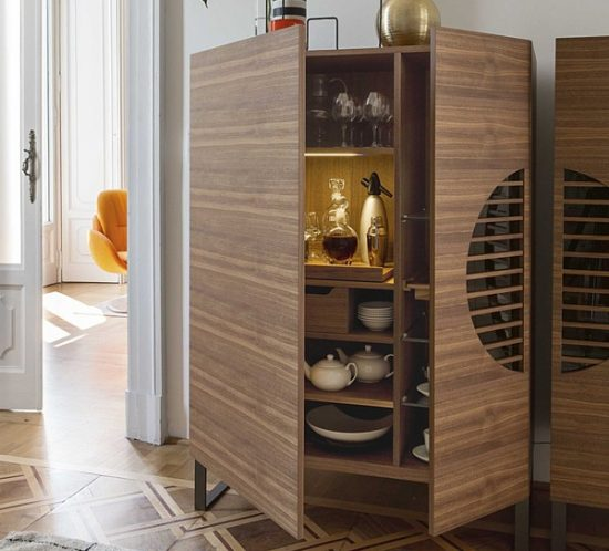 Front view of a Porada Poliferno Bar cabinet with two doors in canaletta walnut and metal feet