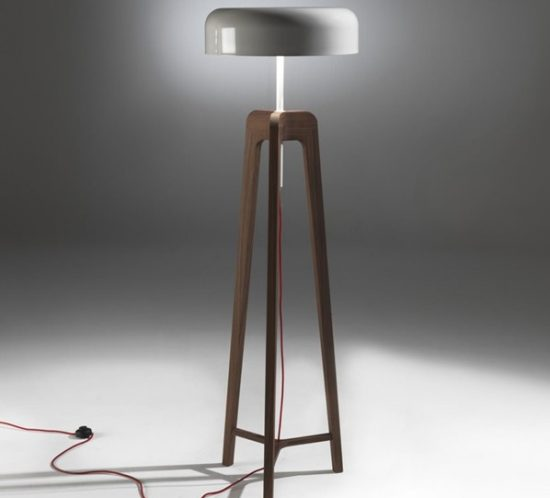 Pileo floor lamp in solid canaletta walnut or ash with metal shade.